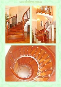 Винтовая деревянная лестница на бетоне.
